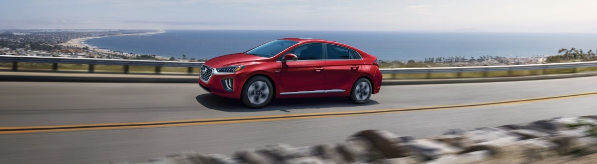 new Hyundai Ioniq Hybrid driving by the ocean