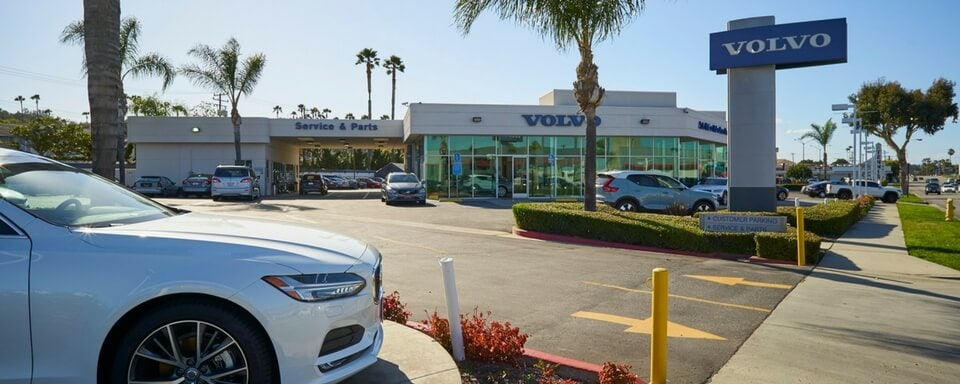 Exterior shot during the day of AutoNation Volvo Cars South Bay, an auto dealership where cars and SUVs are sold.