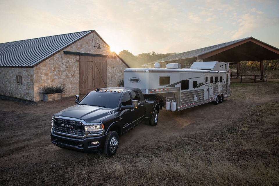 New Ram 3500 Limited MegaCab Truck Towing a Large Trailer
