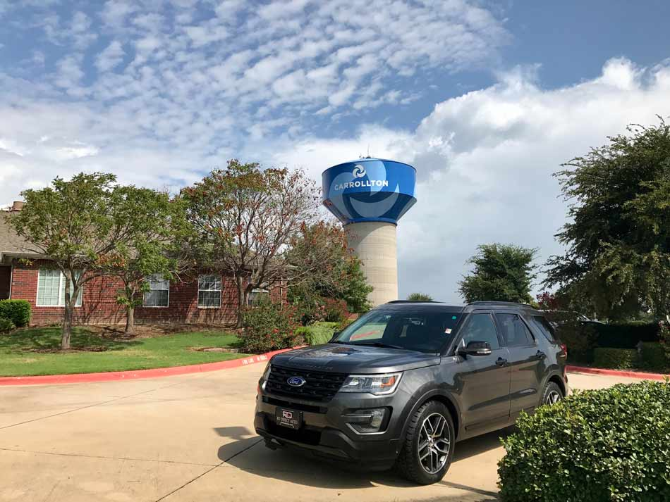 Image shows Ford Explorer in Carrollton and redirects to more information about our dealership, Reagor Dykes Directo Auto of Dallas serving the Carrollton region ?with doorstep delivery