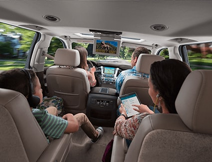 A family in a 2018 Chevrolet Tahoe