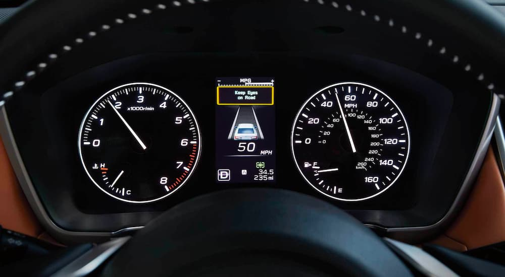 The gauge cluster in a 2021 Subaru Legacy is shown saying keep eys on the road.