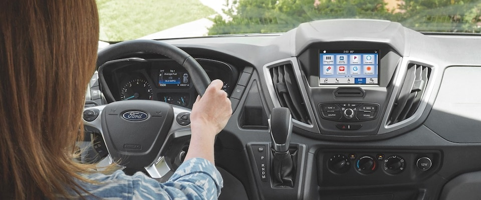 Interior of the 2019 Ford Transit with a person in the drivers seat