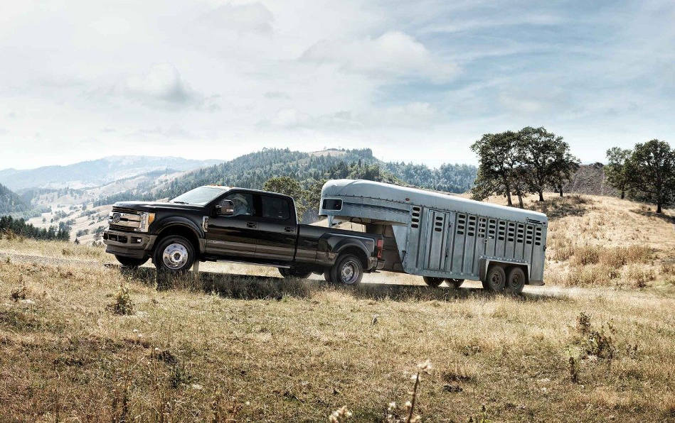 A 2018 Ford F-250 towing a large horse trailer