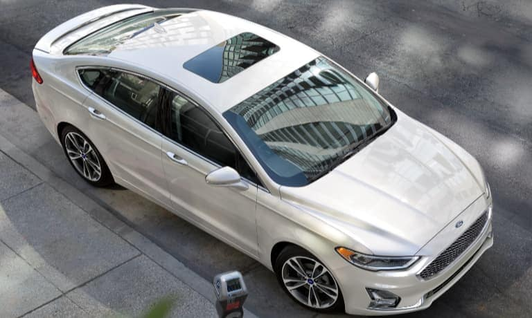 2020 Ford Fusion in white parked on the side of the street view from above