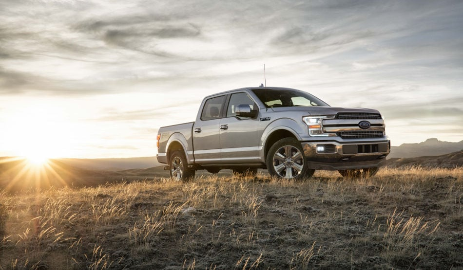 A 2018 Ford F-150 Lariat sitting atop a grassy hill
