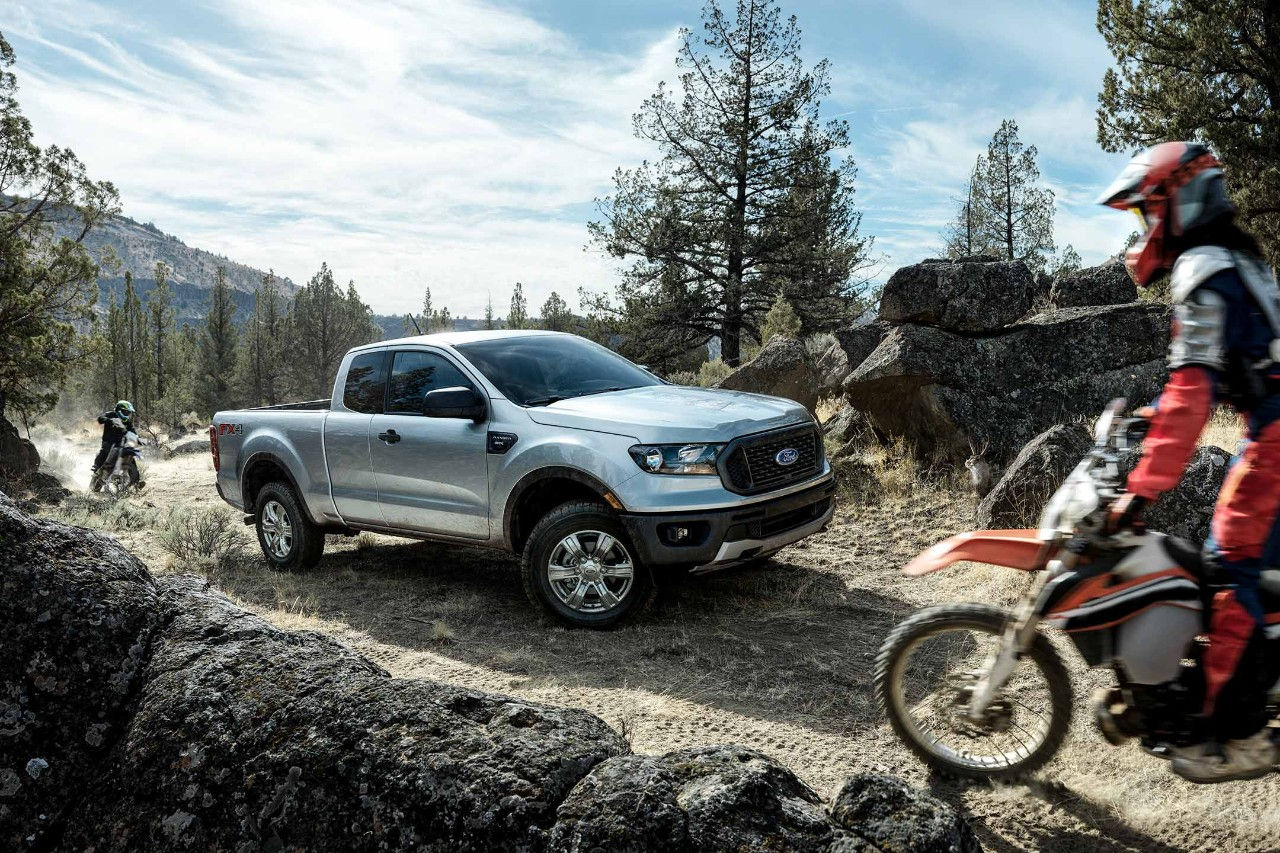 All new silver 2019 ford ranger stx fx4 supercab pickup truck on dirt road