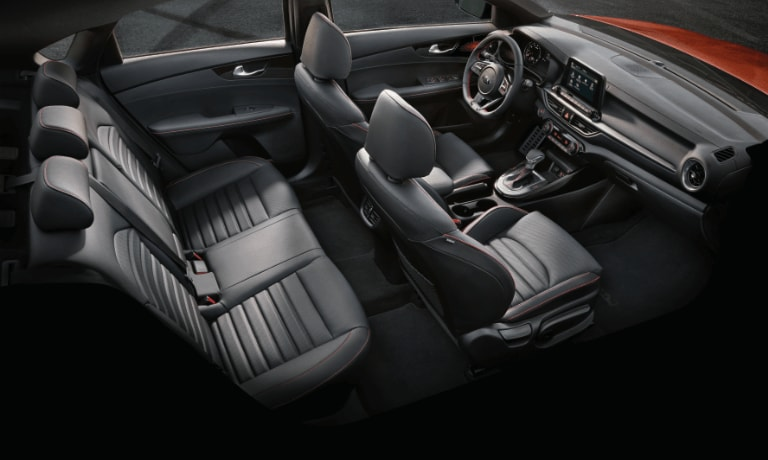 2020 Kia Forte interior in black showing front and back seats