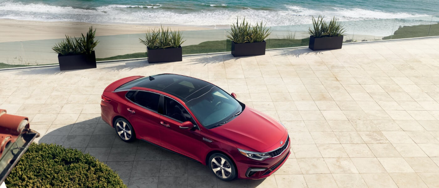 2020Kia Optima Parked in Ocean View Driveway