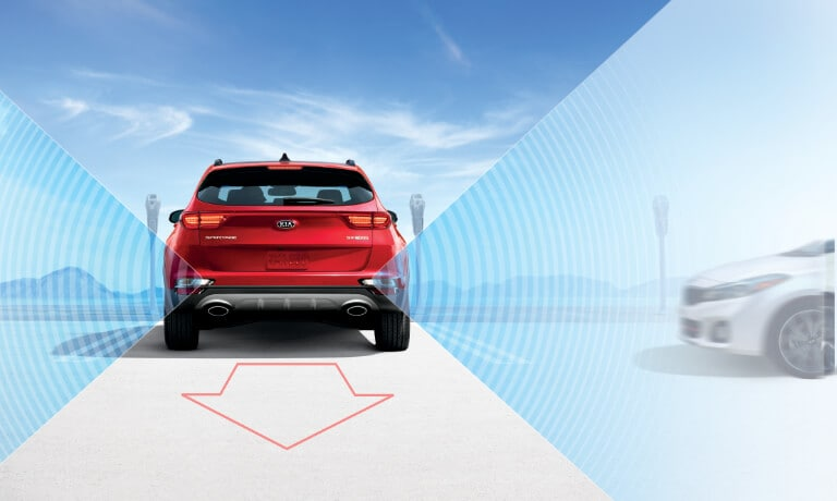 2020 Kia Sportage rear view with side collision sensors