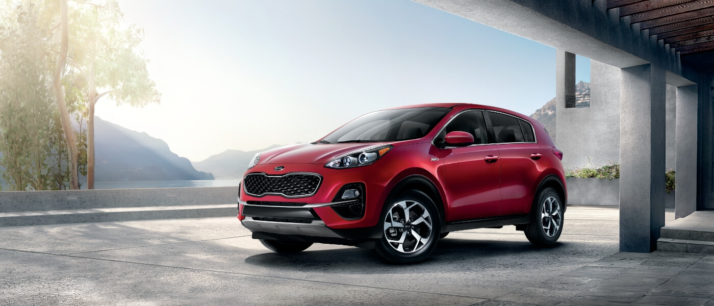 2020 Kia Sportage parked by an office building next to a lake
