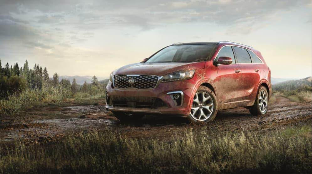 A red 2020 Sorento SX covered in mud