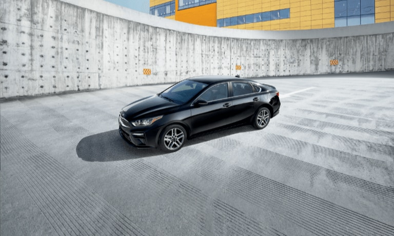 2020 Kia Forte in Black Parked on the upper level of a parking garadge