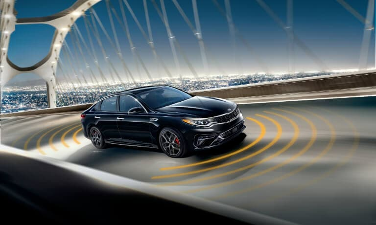 2020 Kia Optima driving on the Highway with collision sensors
