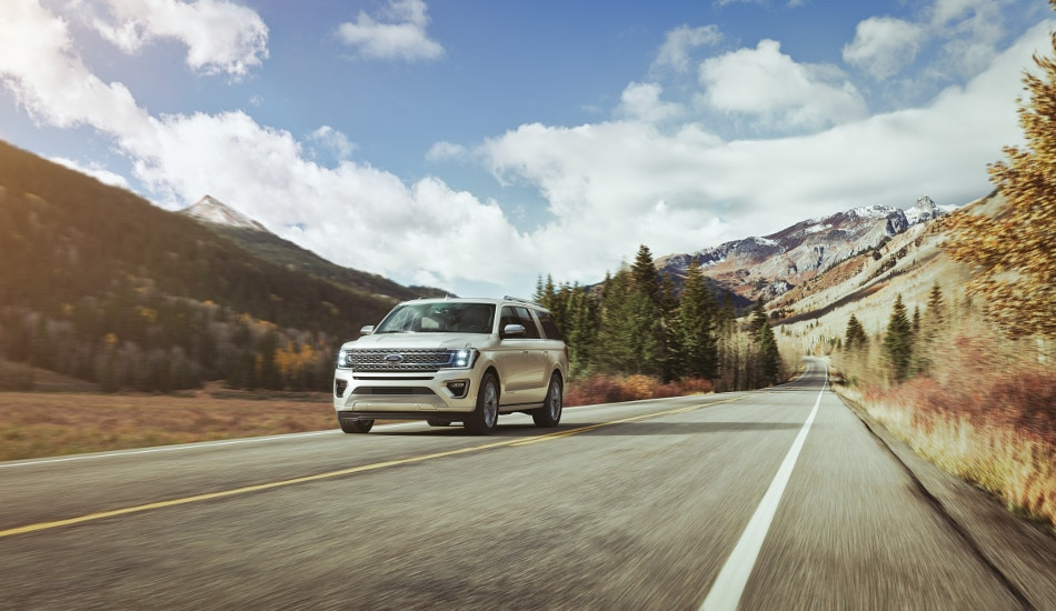 A 2018 Ford Expedition driving through the mountains