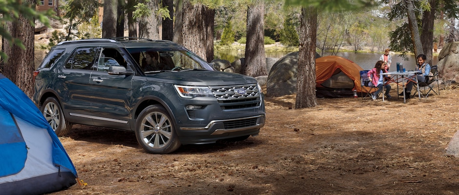 A family camping with their Ford Explorer