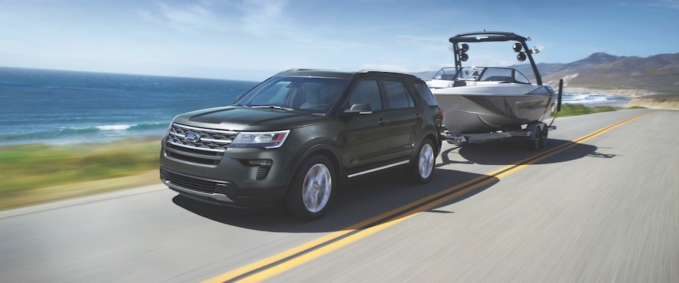 A 2019 Ford Explorer towing a boat by the ocean