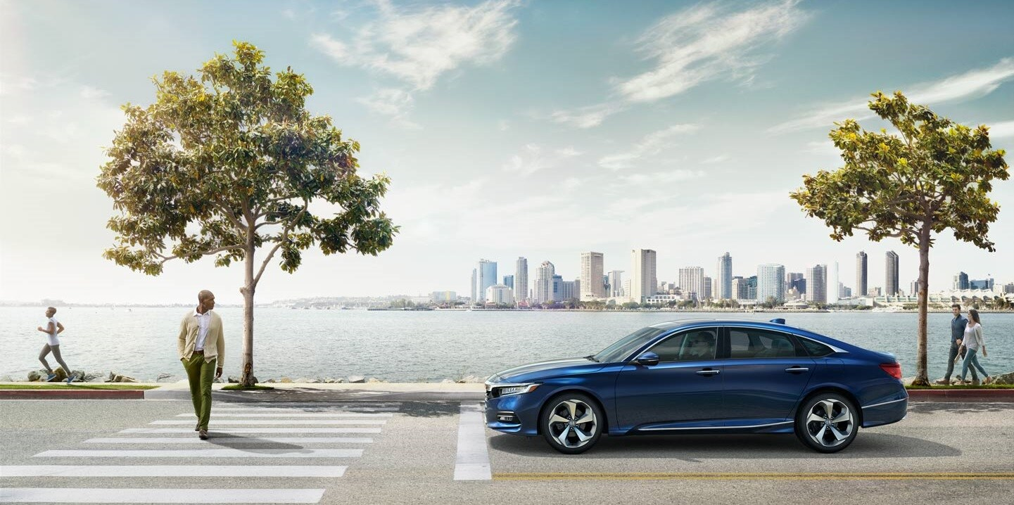 2019 Honda Accord at a crosswalk with a city landscape background