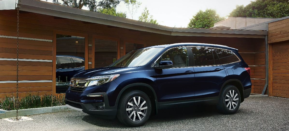 2019 Honda Pilot in front of a house