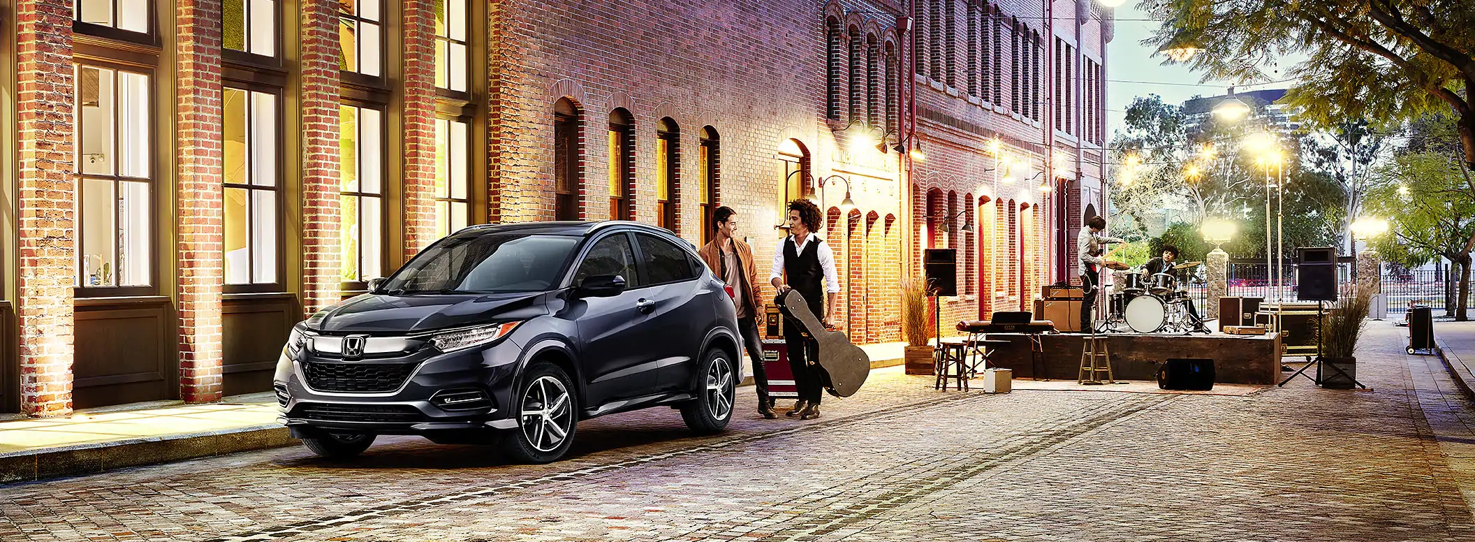 2019 HR-V on brick road with musicians