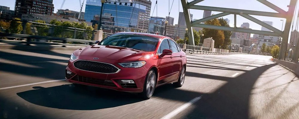 2019 fusion driving across bridge