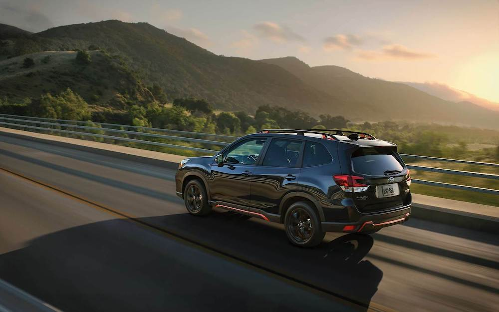 2020 Subaru Forester on a highway at sunset