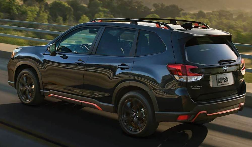 2020 Subaru Forester driving on a highway at sunset
