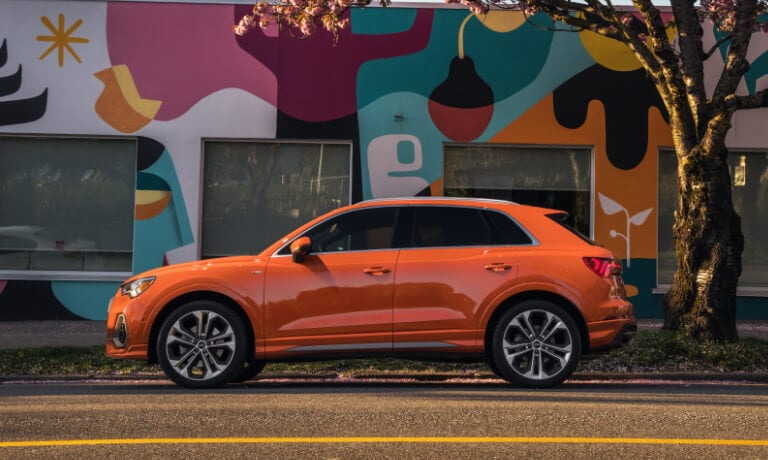 2020 Audi Q3 parked on the street in front of a street mural