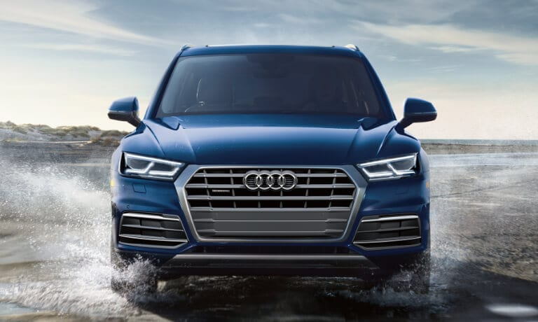 2020 Audi Q5 front view driving through water on a beach