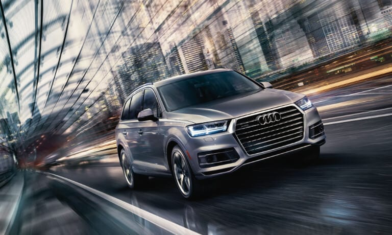 Sivler 2020 Audi Q7 driving in a tunnel