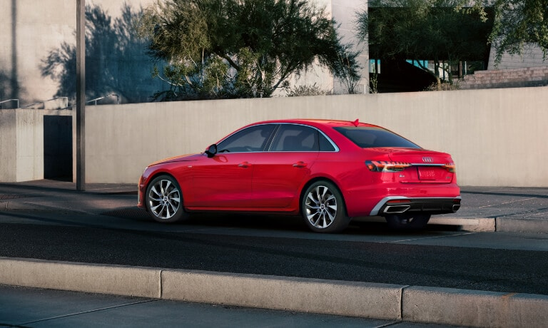 Red 2020 Audi A4 parked on the side of the road