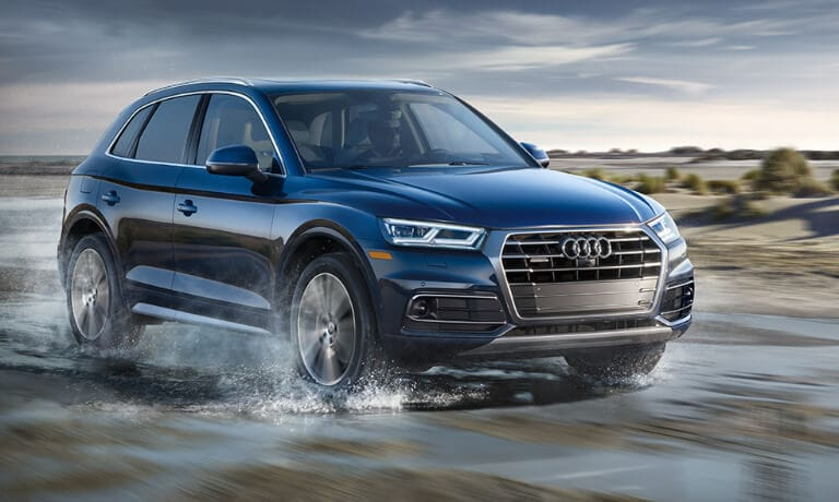 2020 Audi Q5 driving through water on the beach