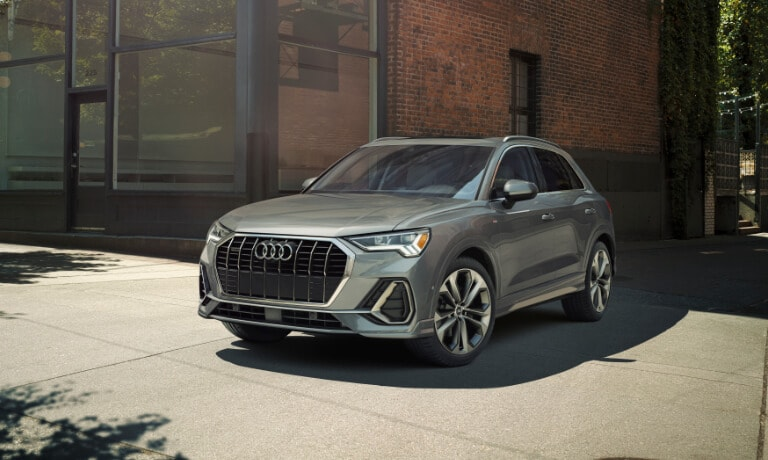 Gray 2020 Audi Q3 pulling out of an alley