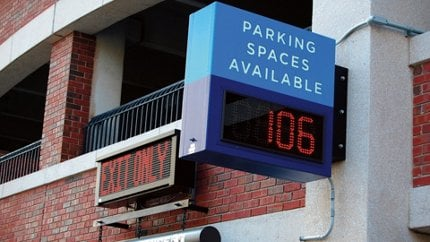 Parking Information sign on building
