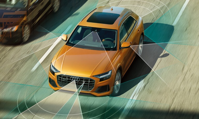 2020 Audi Q8 driving on the highway with safety sensors