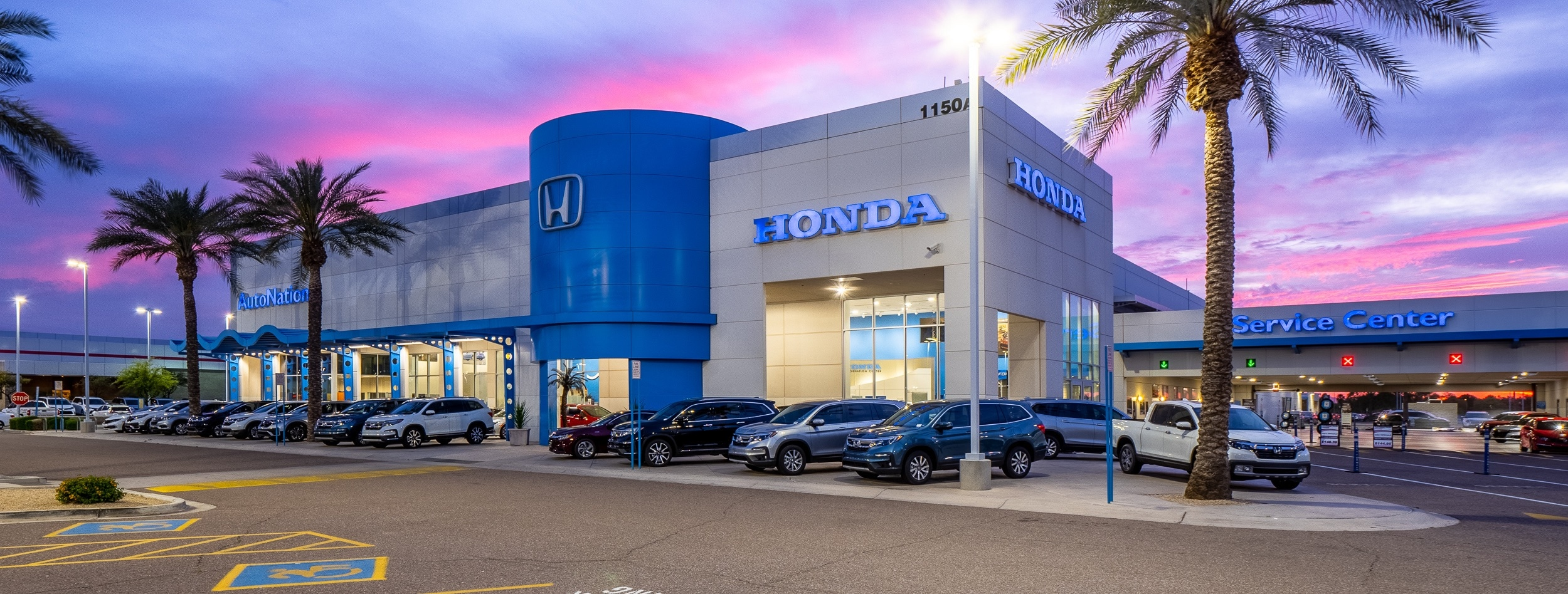 View of AutoNation Honda Chandler at dusk
