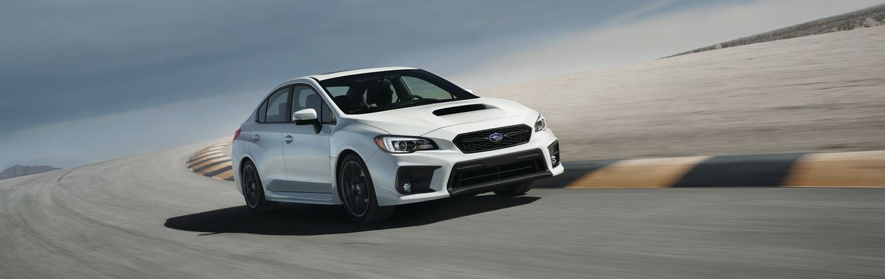 new Subaru WRX driving on a course