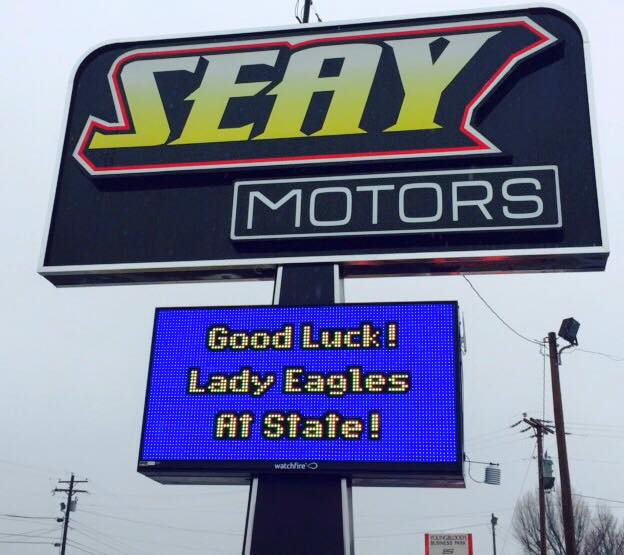 Electronic sign congratulating local school sports team