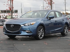 Certified pre-owned Mazda vehicles 2018 Mazda Mazda3 4-Door Touring Car for sale near you in Ann Arbor, MI
