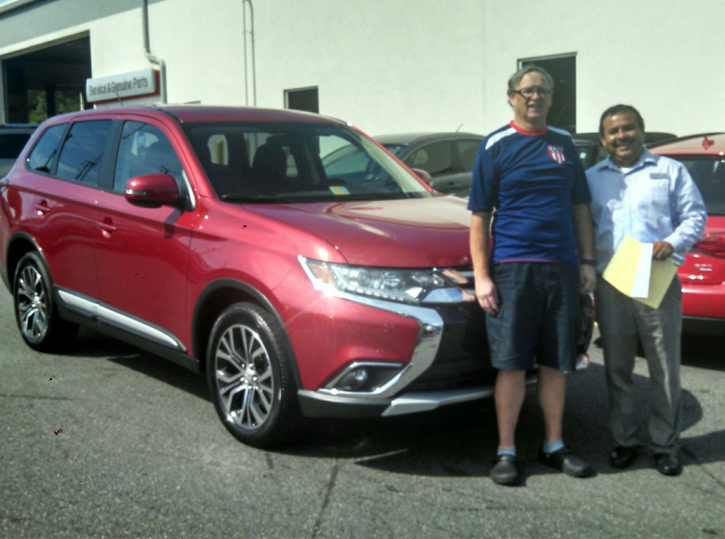 Happy Customer Robert Ainsworth with salesman Sal Sauceda.
