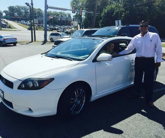 Salesperson Johnathan Sauceda with Happy Customer Emily Eliss and a new-to-her 2009 Scion TC.