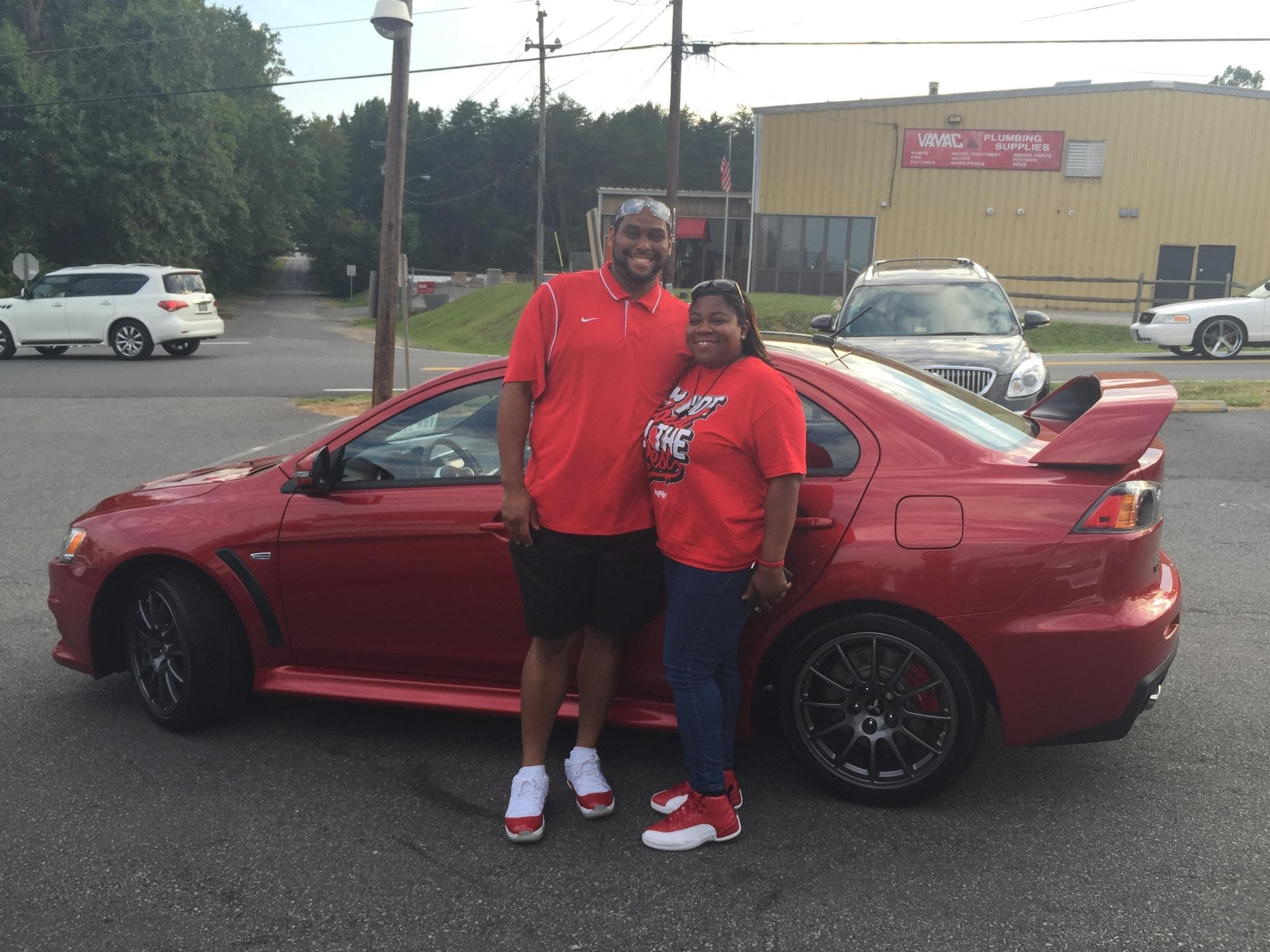 With help from Dawn DeChristopher, Happy Customers Stephen and Sharonda Posey bought the LAST Final  Edition Lancer EVO on the lot and a 2014 Buick Enclave!