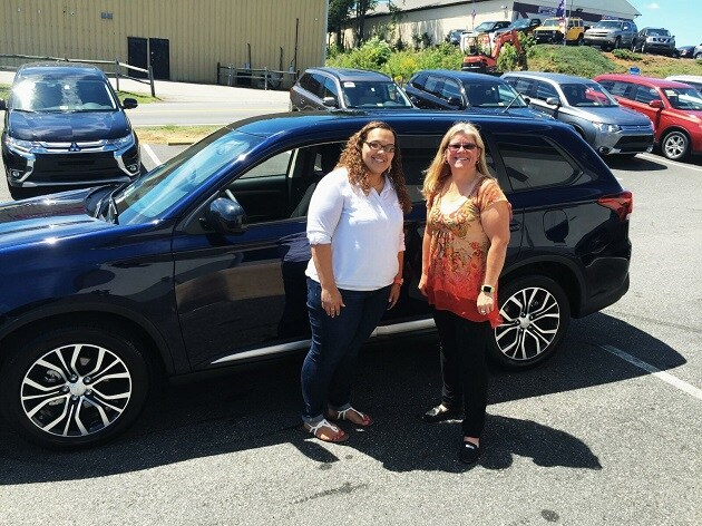 Salesperson Dawn DeChristopher with Happy Customer Deserae Barney and her brand new 2016 Mitsubishi Outlander.