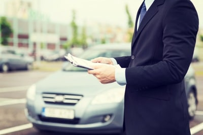 Person Reviewing Finance Application At A Dealership | Bad Credit Financing in Walled Lake, MI