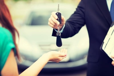 Customer Receiving Keys To A New Car | Bad Credit Financing in Walled Lake, MI