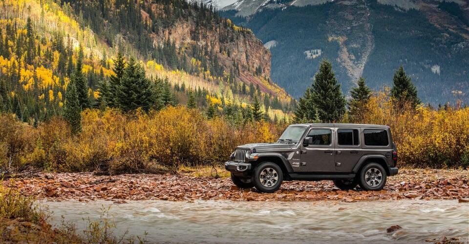 2018 Jeep Wrangler Parked On Rocks Near A Mountainside