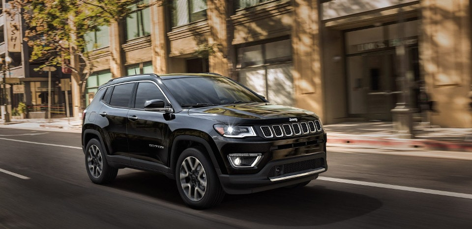 2018 Jeep Compass driving on a city road
