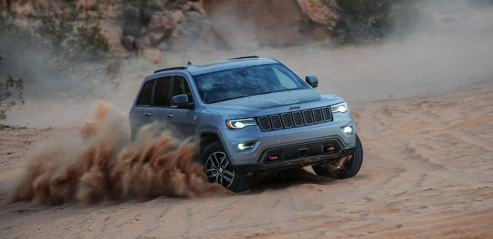 2018 Jeep Grand Cherokee driving through sand