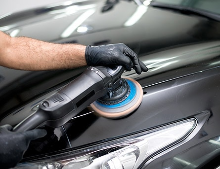 Car buffer buffing out scratches.