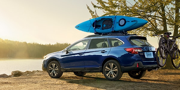 New Subaru Outback by the lake